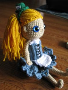 "Alice doll with a little Mad Hatter top hat. I tried to make her dress sort of ""pin up"" style... it sort of worked!"