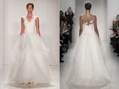 Ball gown wedding dress with a sheer sweetheart neckline hand beaded bodice and soft tulle tiered skirt