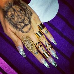 Too long for my taste but I like the design .. Dope lion tattoo too ..