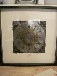 repurposing an old clock face in a frame with metal corner edges and a notecard