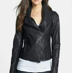 VINCE leather Scuba Jacket tagged $995 Lustrous lambskin upgrades a wide-lapel jacket designed with an asymmetrical closure, decorative topstitching and rib-knit panels for easier movement. Imported.100% lamb leather.Contrast: 80% wool, 20% spandex.Lining: 100% cotton (body); 80% wool, 18% nylon, 2% spandex (sleeves).Dry clean by leather specialist only. Vince Jackets & Coats