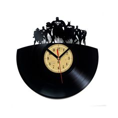 Vinyl Record Clock  Justice League. by TheVinylClocks on Etsy - for Zach or one of the other 2