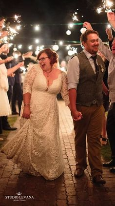 Plus size real bride in a full lace corset a line curvy gown with long sleeves from Studio Levana