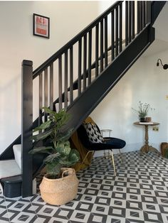 From a small dark hallway we added a roof life to floor the space with light from above. We also changed the carpet to these monochrome floor tiles and painted the stairs and bannister in Railings by Farrow and Ball. Dark Staircase, Dark Hallway, Tiled Hallway, Hallway Flooring, Modern Hallway, Staircase Design, Entrance Hall Decor, Hallway Ideas Entrance Narrow, Entryway