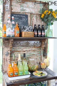 Adding shelving and a galvanized tray turns a vintage door into a rustic beverage station that will be the hit of your next party. Get the tutorial at Finding Home.   - CountryLiving.com
