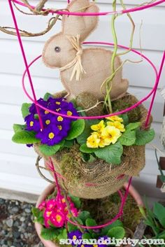 Stuffed Burlap Easter Bunny.  Like the dea of using the tomato cage to hold the primrose pots!