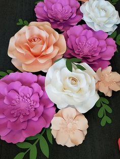 This listing is for 9 paper flowers. The flower styles in the photo are the styles the flowers will come in. 2 Large Roses 18-20 2 Medium Roses 15-17 3 Medium Flowers 15-17 2 Mini Flowers 7-8 Colors of your choice are welcome. Gold, Silver or Rose Gold $10 extra, please message