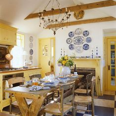 Designer Gary McBournie: This kitchen was reconstructed to closely resemble the original one in an old Nantucket home; a yellow, blue, and white palette gives it abundant energy and warmth.