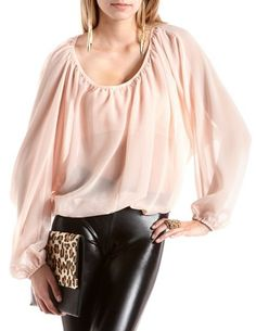 From our Bloom collection! This flowy blouse comes in sheer chiffon fabric with an open back and elasticized hem. Fits with long, balloon sleeves and a scoop neckline.