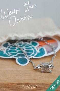 Enjoy a moment at sea with this stunning Sea Turtle Necklace. Wear our Sea Turtle Necklace to your favorite beach on a summer day or feel the beach vibes all year round. You can contribute in saving our ocean by purchasing from us! Visit atoleajewelry.com to know more.