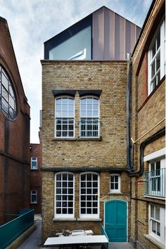 New extension with skylights on top of an old Victorian brick building for a private school on a constrained site in London by Studio Webb architects.