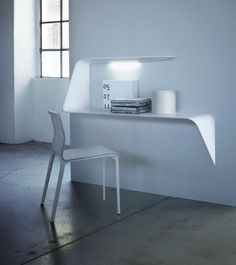 """This Mamba desk is so elegantly minimalistic. To me, it expresses a typographic accent. """"The Mamba desk was designed by Victor Vasilev and looks very simple and almost disappears into the wall. Look closer and you'll get to see how refined and elegant the desk really is. It can be installed on any wall and combines all the basic functions in one stunning design."""""""