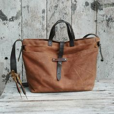 Waxed Canvas Tote: Spice, antique military leather, homespun fabric.. $220.00, via Etsy.