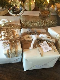 White paper, with burlap, gold and silver accessories. Christmas 2015