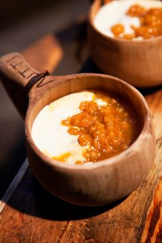 cloudberries with a sauce in a kuksa