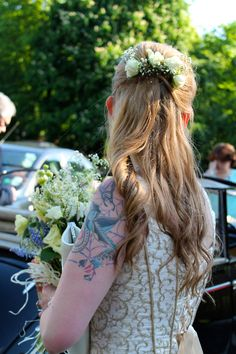 Bridesmaid with bouquet and hair flowers.