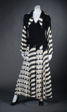 In August 1965, British Vogue featured the designs of Ossie Clark, a recent graduate of London's Royal College of Art. Clark's graduation collection featured the graphic patterns and short shift dresses that were popular in the freewheeling milieu of mid-1960s Swinging London. Within a few years, Clark's style had evolved, relying on dramatic sleeves, peek-a-boo cut-outs, flowing skirts, and a defined waistline to create a flattering, overtly feminine silhouette. Clark's aesthetic was…