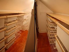 """elfa"" closet organization for creating a closet in a bedroom with a steeply slanted roof"