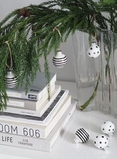 Alternative Christmas tree - a festive branch in a vase with black and white striped baubles. A minimal, monochrome Christmas on a budget with Homesense - cate st hill Minimal Christmas, Scandi Christmas, Christmas On A Budget, White Christmas Tree Decorations, Christmas Tree Branches, Holiday Decor, Alternative Christmas Tree, Homesense, Christmas Aesthetic