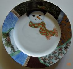 Hand painted Christmas plate with decorative borders and a snowman
