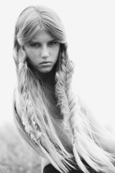 Double messy fishtail braids in front, loose hair in back