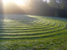 Labyrinth at Burford Priory, courtesy of St. James's Piccadilly. Beautiful shadowing really emphasises the beauty in a simple turf labyrinth.
