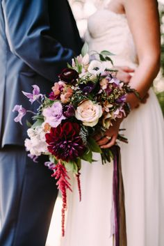 We love this richly hued bouquet: http://www.stylemepretty.com/2015/02/24/whimsical-summer-camp-forest-wedding/   Photography: Cambria Grace - http://www.cambriagrace.com/