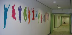 Raised supergraphic spanning 23 metres runs along the main school corridor