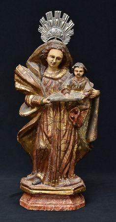 Santana Caminhante com Nossa Senhora, imagem em monobloco de madeira ricamente policromada, com resplendor de prata. Brasil, séc. XIX. Alt. 32 cm. Base R$1.200,00. Abr16