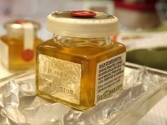 Pure honey with solid 9ct gold label, finished of with silk also available in 18ct or platinum www.BeeARTisan.com