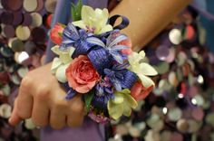 Unique Prom Corsages | Prom Time! What Is Your Prom Style? if the flowers go all the way around I like it, if not?  it's just another wrist corsage w/strange color matches!