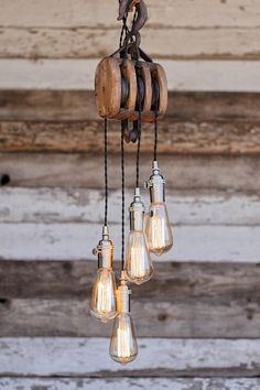 Items similar to The Cascade Chandelier - Metal Barn Pulley pendant Light - Edison bulb Industrial Hanging fixture - modern Rustic ceiling Lighting on Etsy Cabin Lighting, Farmhouse Lighting, Rustic Lighting, Farmhouse Kitchen Decor, Lighting Design, Lustre Industrial, Industrial House, Pulley Light, Retro Lampe