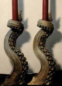 Octopus Tentacle Candle Holder - Set of Two - Antiqued Bronze Finish. Representing the unknown perils of murky ocean depths and those beyond the mundane world, the tentacle hails from Lovecraftian horror and ancient tales of sea monsters.Two 10