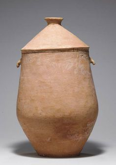 A rare large red pottery jar and cover, Neolithic period, probably Qijia culture, circa 2050-1700 BC