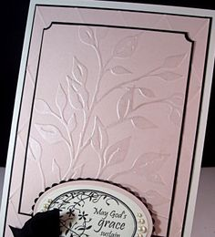 I love the shimmery card with the pearly embossing.