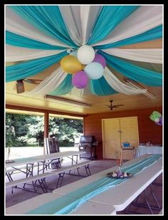 Plastic Table Clothes And Balloons As Big Top Ceiling.