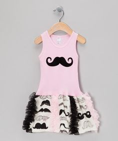 A swanky 'stache characterizes this hip dress. The cheeky print, charming drop-waist silhouette and playful ruffle skirt ensure that little ones rock a design that celebrates a fabulous facial hair affair!