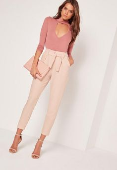 From daytime to playtime, these cigarette trousers have you covered, girl! In a pleated waist, nude hue with pink undertones and a tie belt fasten, you'll steal the scene.