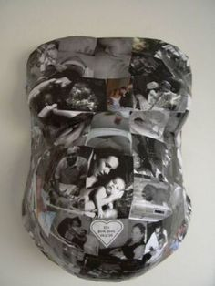Belly cast with photos of the couple.
