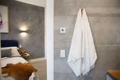 Simple and stylish grey ensuite with brass features. Luxury look ensuite...