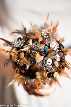 Feather and button bridemaids bouquet