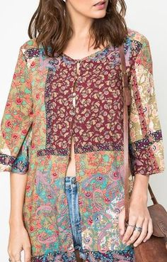 A gorgeous, bohemian inspired, vintage-style patchworkprint makesthis sheerdusterinto a memorable statement piece to love all year long! We recommend pairi