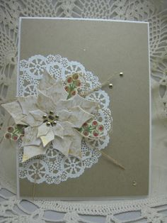 handmade Christmas card ... White/Gold die cut and layered Poinsettia sits on off-the-edgy white embossed doily ... kraft base ... brads in center ... looped linen threads ... great card!