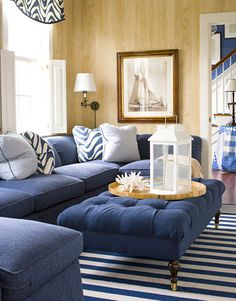 blue poof and striped rug...