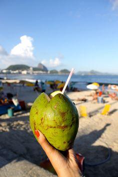 Cheers to Copacabana beach with fresh coconut water   Check out my top 5 things to do in Rio de Janeiro https://www.youtube.com/watch?v=LXB3Hy1u1Qg