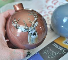 Deer head sticker on an ornament. fun way to personalize! Use stickers with clear backgrounds to make fun,personal ornaments!