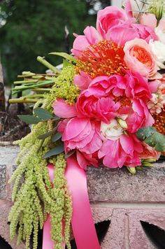 Striking hot pink bouquet with orange pincushion and green amaranthus via Blossoms Sweet Blog.