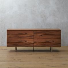 Shop linear long low dresser.   MASHstudios goes against the grain with long, low-laying storage in acacia veneer.  Four elongated drawers glide silently with subtle pulls.