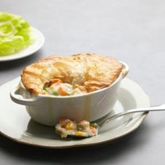 Try these irresistible low calorie individual chicken potpies! The crust is a crisp easy phyllo crust topping. Make a double batch and freeze the extras to have anytime! @EatingWell Magazine
