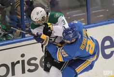 St. Louis Blues Patrik Berglund of Sweden checks Dallas Stars John Klingberg of Sweden in the first period at the Scottrade Center in St.…